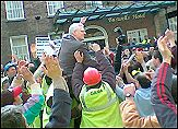 Joe Higgins Socialist Party TD carried on the shoulders of the victorious Gama workers