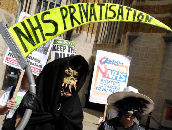 The Socialist Party's 'Grim Reaper' joins the Keep Our NHS Public 'Defend our health service' protest outside the Department of Health on the 60th anniversary of the founding of the health service, photo Paul Mattsson