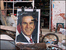 Shoes are commonly pressed against pictures of US President George W Bush in the Middle East, considered a serious insult