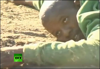 Mine workers hits the ground as firing starts - Russia Today video still