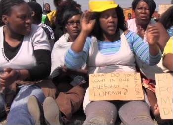 Striking mine workers' wives join the protest in Marikana