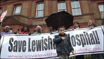 Saturday 24 November, defying cold driving rain, up to 10,000 residents and staff marched to defend Lewisham Accident and Emergency (A&E) and linked arms around it., photo Socialist Party