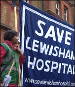 Save Lewisham Hospital demonstration: Saturday 24 November, defying cold driving rain, up to 10,000 residents and staff marched to defend Lewisham Accident and Emergency (A&E) and linked arms around it. , photo Socialist Party