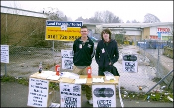 Successful TUSC candidate Joe Robinson (left) with Shaun on a TUSC stall in Maltby, Yorkshire. photo by Alistair Tice