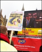 PCS stage outside parliament, with screen showing Budget speech, 20.3.13, photo Sarah Sachs Eldridge