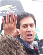 Ed Miliband confonrted by Bedroom tax protestors, photo Chris Moore