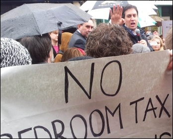 Ed Miliband confronted by anti-bedroom tax protestors demanding that Labour councils refuse to collect the tax, photo Chris Moore