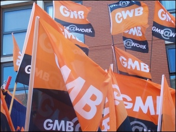 GMB flags at the TUC demo in Manchester: 50,000 march against Tories demanding action on NHS, photo Claire Job