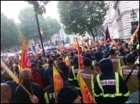 Massing outside the gates of Downing Street, 16.10.13, photo Mick Cotter