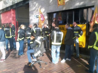 Bow fire station pickets listening to LBC radio reports on the strike, photo by N Byron