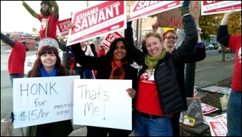 Seattle councillor Kshama Sawant campaigning for a $15 an hour minimum wage, photo Socialist Alternative