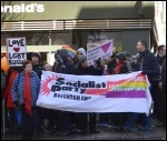 Brighton Socialist Party members taking part in a Birhgton LGBT solidarity protest on the opening day of the 2014 winter Olympics, photo Serena Cheung