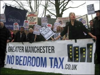 Bedroom tax anti-eviction protest, Salford, 10.4.14, photo Hugh Caffrey