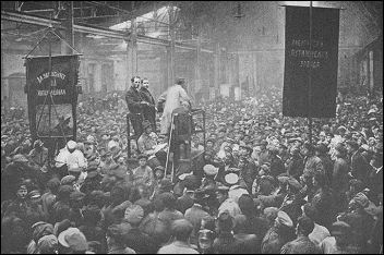 the Putilov Factory in Petrograd. Banners and speakers proclaim the International unity of all races and peoples.