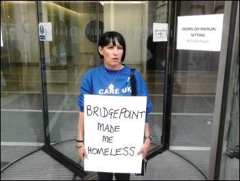 Mags Dalton, made homeless by Care UK pay cuts, protests outside Bridgepoint office in London, 08.08.2014