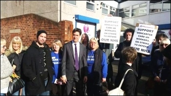 Care UK strikers 'photo-bomb' Miliband