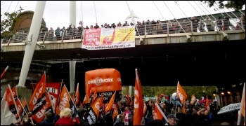 GMB contingent marches under the Socialism 2014 banner on Jubilee bridge, photo by Dave Reid