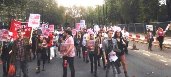 Fast Food Rights protesters head for McDonalds, photo Helen Pattison