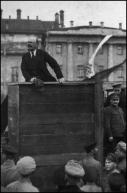 Lenin speaking at a 1920 demonstration, flanked by Trotsky