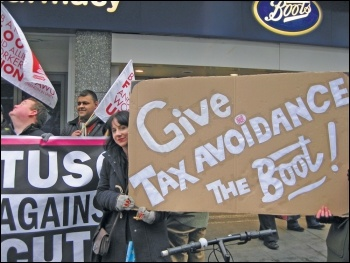 Leicester TUSC supporters protesting outside Boots over tax avoidance, photo Leicester SP