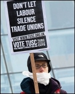 A TUSC supporter protesting outside Labour's Collins Review conference in 2014, photo Paul Mattsson