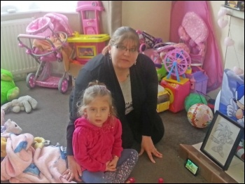 Laura Sharpe and her daughter in their 'temporary' home in Ilford