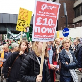 £10/hour Now placard on the People's Assembly demo, 20.6.15, photo by Judy Beishon
