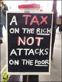 A placard on the People's Assembly anti-austerity demo, 20.6.15, photo Judy Beishon