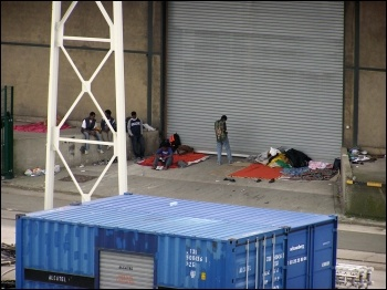Migrants at Calais, photo Tom Jervis (Creative Commons)