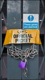 RMT official picket armband on locked station gate, photo Naomi Byron