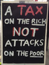 Placard on the 20 June anti-austerity demo, photo by Judy Beishon