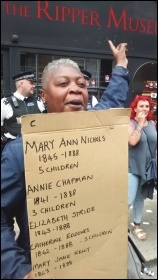 A woman protesting outside Tower Hamlets' new Ripper museum, photo by Socialist Party