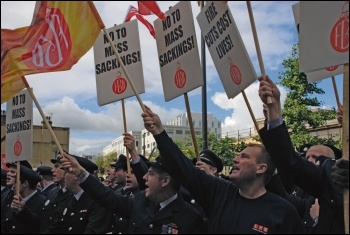 FBU members marching against job cuts, photo by Suzanne Beishon