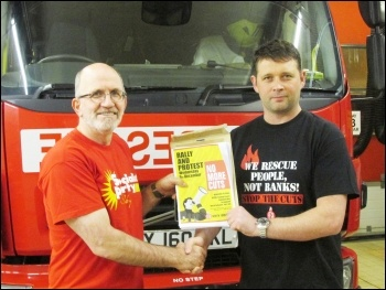 Bernard Davies, Selby Socialist Party secretary, handing over a petition  to Steve Howley, North Yorkshire FBU secretary, photo by Selby Socialist Party