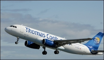A Thomas Cook passenger plane - cabin crew are to strike against cuts to break times, photo by Arpingstone (Creative Commons)