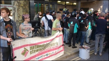 NSSN & Socialist Party brings solidarity to the protest outside Deliveroo head office, photo James Ivens