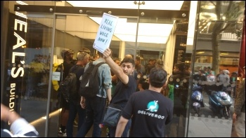 A Deliveroo workers' delegation enters the company HQ for talks with management photo James Ivens, photo James Ivens