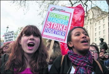 Lily (left) marching with teachers and junior doctors photo Paul Mattsson