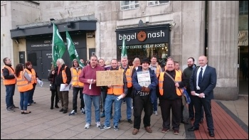 Socialist Party members join RMT strikers on the picket line at Leeds train station photo Leeds SP