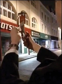 Tory student Ronald Coyne trying to burn money in front of a homeless person