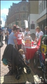 Derby Socialist Party campaign stall in support of Derby Women's Centre 12 August 2017, photo Derby SP