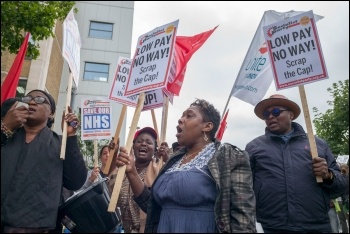 Outsourced NHS workers in east London on strike against poverty pay in 2017, photo Paul Mattsson