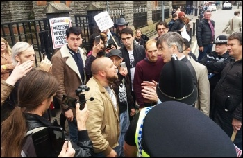 Socialist Students confronting Tory MP Jacob Ress-Mogg in Cardiff, photo by Cardiff Socialist Party