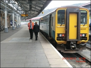 Train guard at Swansea station, photo Lobster1/CC
