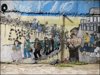 Communist Party mural that commemorates Santa Maria school massacre on the right, photo Rodrigo Fernandez/CC