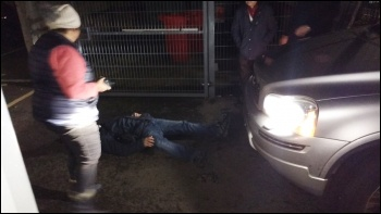 The scene after an academy consultant apparently barged his car into a peaceful protester, photo by James Ivens