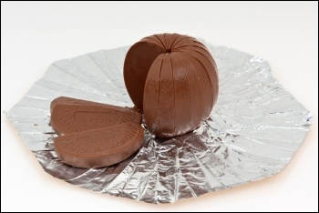 You now get less chocolate orange for the same price - increasing profits while cutting your chocolate, photo by Evan-Amos (CC)