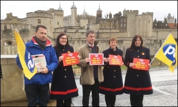 PCS members, including assistant general secretary Chris Baugh (centre), with NSSN chair Rob Williams (left), outside the Tower of London for the 31 January PCS pay day protests., photo Paula Mitchell