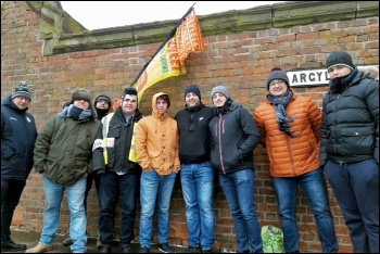 The RMT picket line in Birkenhed was joined by Elvis (fourth from left), 3.3.18, photo by Hugh Caffrey