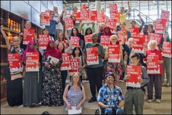 Kshama Sawant (centre) has championed the fight against injustice - pictured here campaigning for socialist housing policies, photo by Socialist Alternative